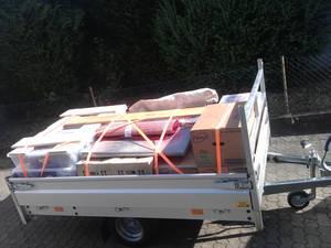 Seitenansicht Hapert Amigo TOP mit H-Gitter, Kisten beladen verzurrt